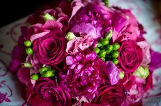 Bright pink bride bouquet with highlights of pink roses. #wedding #flowers #yannidesignstudio