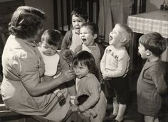 War time children receiving their daily dose of CLO Cod Liver Oil, Health Care, Couple Photos, Children, War, Life, Vintage, Couple Shots