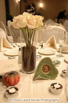 Centerpieces: Clear vase filled with coffee beans and a single paper rose...wrap the vase with royal blue and lime green ribbon around the top.