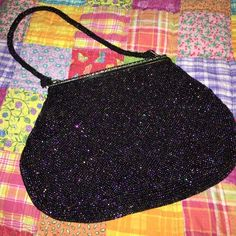 Antique beaded purse Antique beaded purse - looks like dark purple iridescent beading with dark greens, blues & bronze. Beautiful. The strap is also beaded. I don't think the top snaps shut Bags Clutches & Wristlets