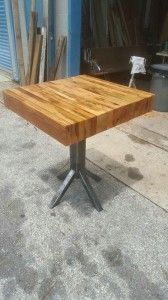 Butcher block made with reclaimed wood and unique steel base. 31 1/2 L X 30″W