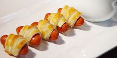 piggies in a blanket all you do in cut crosont triangles into halfs only if you use the small ones which taste so much better then you wrap the mini hot dogs in them and pop in the oven for about 20-22 min. then SERVE YUM YUM YUM YUM FAVORITE FOOD