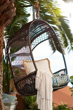 Give your mother the day off and let her relax in her new outdoor Swingasan®, featuring an airy, open-weave back, side compartments for her drink and a canopy that provides cool shade—all in weather-proof synthetic rattan that's been woven by hand over a sturdy, rust-resistant iron frame.
