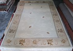 """Carpet is graded using numbers, like 9/25, or 8/22. The top number of the """"fraction"""" represents knots in 9/10 of an inch of width & bottom number represents knots of 4 1/2 inches of the rug's length. 0.9"""" x 4.5"""" equals 4.05"""", almost 4 square inches, so an easy conversion would be to multiply the two numbers together and divide by 4 (sq. in:) to get the approximate weave m knots per sq. in. For example; with a 9/25 quality rug, 9 X 25=225,225/4=56 knots per sq. m…"""