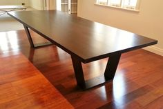 American oak table finished in Black Japan, i LOVE the tapered legs and sleek lines www.rzid.com.au
