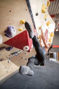 Nina Williams kicks off the wall at the Front Climbing Gym, Salt Lake City. Photo: George Bruce Wilson