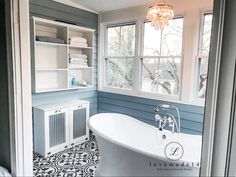 Gorgeous ship lap bathroom with tilt out laundry hamper