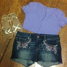 """American Eagle embroidered cut off shorts NWOT Dark washed American Eagle cut off shorts with frayed hem. The pockets are embroidered with a beautiful floral pattern. Size 10. 3.5"""" inseam. No trades. American Eagle Outfitters Jeans"""
