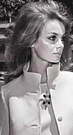 """1965: Jean Shrimpton at the 1965 Melbourne Cup where she sparked off a scandal with her minidress (designed by Colin Rolfe). Not only was it five inches above her knees, she further scandalised Australians by not wearing stockings (nor gloves). 'I was surrounded by cameramen, all on their knees like proposing Victorian swains, shooting upwards to make my skirt look even shorter. I had no idea this was going to happen - this was publicity that I had certainly not planned."""" KA"""