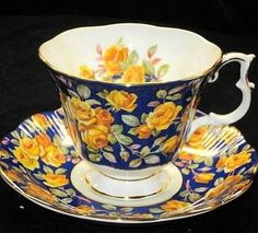 Navy teacup with yellow roses