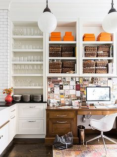 Love this open shelving with a mix of wicker storage baskets and colorful Hermes orange boxes on display!