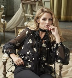 Olivia Palermo wearing a Chloé shirt, skinny scarf, and pants.