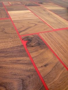 Reclaimed walnut tabletop with red thermoset resin.  Do want.