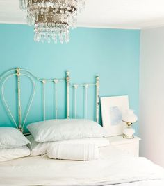 Love the chandelier against the turquoise.