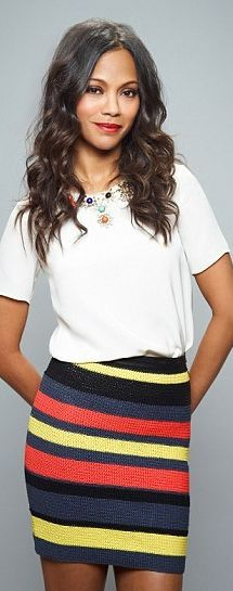 Who made  Zoe Saldanas necklace, white tee, and stripe skirt?