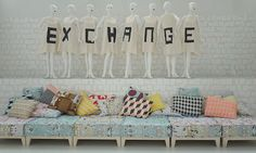 line up some pallets on casters to mimic this look. Love the pillows!