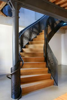 Paying homage to the Baroque staircase attributed to 17th century English master Edmund Pearce, workshop/apd fashioned a contemporary update for a modern Tribeca loft. Where Pearce incorporated oak leaves and pine cones, workshop/apd digitized interlaced tree branches to create an element of modern-day beauty and craft in water-jet cut steel, bringing fancifulness and ornamentation back to architecture. Made of perforated steel. The staircase was fabricated by Ferra Designs.