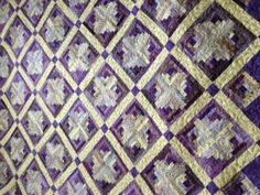 Emily Jane pattern by Pat Wys owner and designer of Silver Thimble Quilt Co. The original pattern she has in red. But I have to say she has outdone herself with the same pattern in shades of purple. Absolutely stunning! Quilted by Leisa Wiggley.