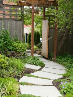 A curving stone path leads through the garden.