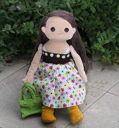 "Dressable doll ""anika"" in her blue & brown dress.  http://www.anikaclub.com"