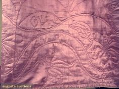 18th c. quilted petticoat. Soft lilac-pink silk satin, quilted to dyed pink worsted tabby with wool batting, quilted in running stitches in design of arches above undulating floral design. Augusta Auctions.