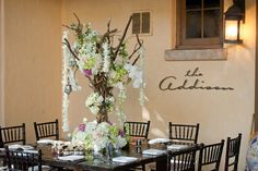 Outdoor wood table perfect for the unique vintage estate turned weddings and events venue!