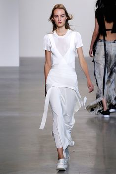 He purposefully started to let things come apart at the seams. Bandage dresses were thrown over t-shirts and artfully unwrapped and unbanded, while loosely knit sweaters were tugged and snagged and held together with chains.    - HarpersBAZAAR.com