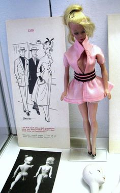 So it turns outBarbie's original design was based on a German adult gag-gift escortdoll named Lilli. That's right, shewasn't a dentist or a surgeon, an Olympian gymnast, a pet stylist or an ambassador for world peace. And she certainly wasn't a toy for little girls...   Lilli on display at the