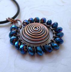great spiral pendant!!                                                                                                                                                                                 Más