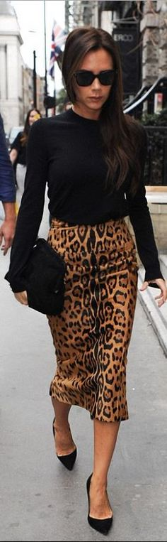 Victoria Beckham's black suede handbag, sunglasses, and leopard skirt that she wore in London