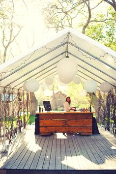 pretty and interesting idea for the bar/buffet area for an outdoor wedding...