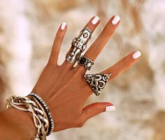 Seriously though, anyone that knows me knows this is my dream hand! Lol.  White nails, tan, lots of silver, giant om ring.  Sigh....