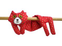 A cute handmade Flat Cat rice pack that can be used as a heat pack or cold pack and is designed to drape around the neck but would also be