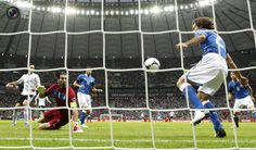 Italy's Pirlo makes a save next to goalkeeper Buffon during their Euro 2012 semi-final soccer match against Germany at the National stadium in Warsaw. PASCAL LAUENER/REUTERS