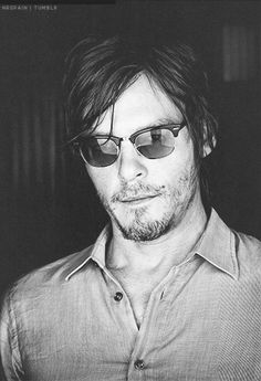 Norman Reedus..I need a man like him..awkward, geeky, and does possibly every type of art there is, hes amazing!