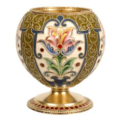 "A Russian silver gilt and cloisonne enamel vodka cup, Feodor Ruckert, Moscow, 1896-1908. The bulbous body worked in multi-color stylized foliate cartouches on a cream ground surrounded by olive green enamel set with scrolling filigree wires . The raised circular base banded with a circle of red enamel beads. Dimensions: 2 1/4"" H x 1 7/8"" W."