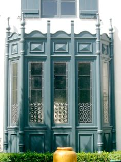 bay window with decorative art glass and spanisheuropean trim