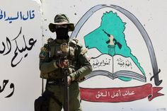 An Iraqi fighter of the Shiite group Asaib Ahl al-Haq stands guard outside the militia's headquarters on May 2015 in the Iraqi mainly Shiite southern city of Basra, as Shiite militias converged. Get premium, high resolution news photos at Getty Images Foreign Policy, Twitter, Master Chief, The Outsiders, City, World, Fictional Characters, Syria, Freedom