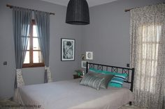 A gray, small master bedroom with feminine touches, designed by #eNJOY architects.