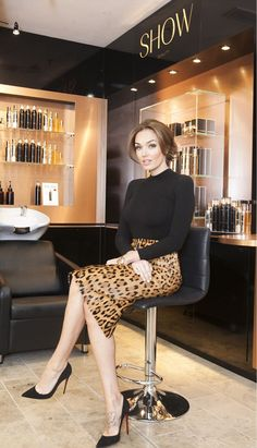 Wear to impress. Cheetah print skirt in tan. Black turtleneck long sleeve. Louboutin heels