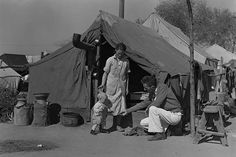 Tom Collins, manager of Kern migrant camp, with drought refugee family. California