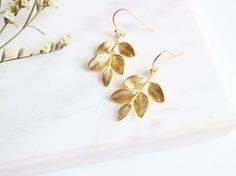 Beautiful highly detailed gold branch earrings.   -Total length measures 3.5 cm -Soft rubber stoppers are included with purchase. -Ear Wires: gold plated over brass, high quality plated. anti-tarnish. -Limited edition.  ------------------- xx --------------------   Your earrings will arrive in a organza bag ready for giving or little treat for yourself. This jewelry bag can be re-purposed to hold your jewelry while traveling.  -All items ship registered mail with tracking number from…