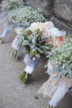 Love how the bride bouquet has a bunch of flowers and the bridesmaids have just baby's breath