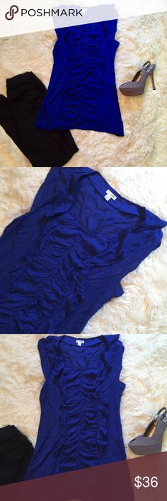 """Anthropologie Odille Cap Sleeve Rouched Blouse 4 Anthropologie By Odille Royal Blue Cap sleeve blouse. Size 4. In excellent condition! Rouched all down the front of the blouse and ruffles around the collar. Exposed side zipper. Measurements: 16"""" pit to pit, 28"""" length. Pair it with your favorite skinny jeans and heels for a night out or simple white shorts and sandals for a more casual look. Anthropologie Tops Blouses"""