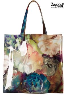 The Ted Baker Blucon is an irresistible shopper bag blooming with stylish swirling florals and has plenty of room for everything you need to tote around on a daily basis. Made of PVC featuring a dark garden floral print.