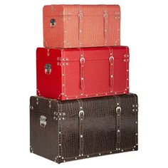 3 wood trunks with croc-inspired faux leather upholstery and buckle accents.  Product: Small, medium and large steamer trunk
