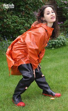 Brunette amateur in black waders and red rain poncho Dog Raincoat, Hooded Raincoat, Mackintosh Raincoat, Girls Wear, Women Wear, Wellies Rain Boots, Rubber Raincoats, Rain Suit, Rain Gear