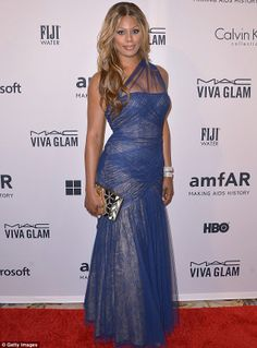 Orange is the New Black star Laverne Cox in a one shouldered blue chiffon gown at the amfAR Inspiration gala http://dailym.ai/1xJiS7b