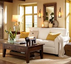 White and beige neutral room with yellow accents and dark wood.