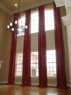 Ideas for Dressing Tall Windows You need window treatments, unless you don't mind waving to your neighbor in your pajamas. But if you have tall windows, what options are there? Tall Curtains, Ceiling Curtains, Curtains Living, Living Room Windows, Long Window Curtains, Curtains Over Blinds, Blue Curtains, Ceiling Panels, Bedroom Curtains